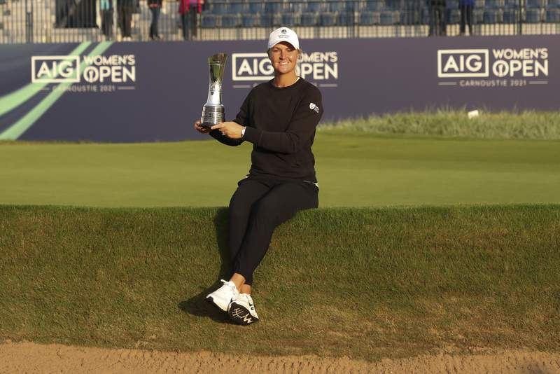 Sweden's AnnaNordqvist poses for the media holding the trophy after winning the Women's British Open golf championship, during the presentation ceremony in Carnoustie, Scotland, Sunday, Aug. 22, 2021. (AP Photo/Scott Heppell)
