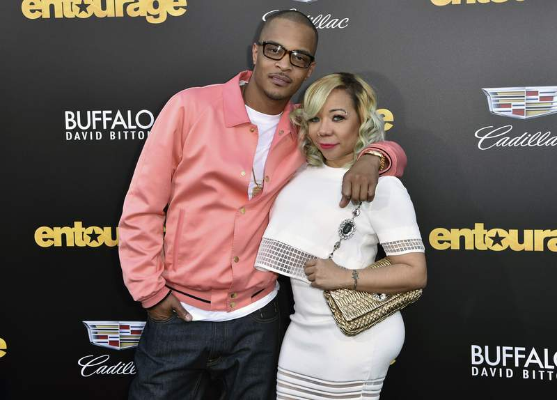 """FILE - In this Monday, June 1, 2015 file photo, T.I., left, and Tiny arrive at the Los Angeles premiere of """"Entourage"""" at the Westwood Regency Village Theatre. Rapper T.I. and his wife Tameka Tiny Harris are under investigation by police in Los Angeles after a sexual abuse allegation. Los Angeles Police officer Rosario Cervantes said Tuesday, May 18, 2021 that an active investigation is underway. (Photo by Rob Latour/Invision/AP, File)"""