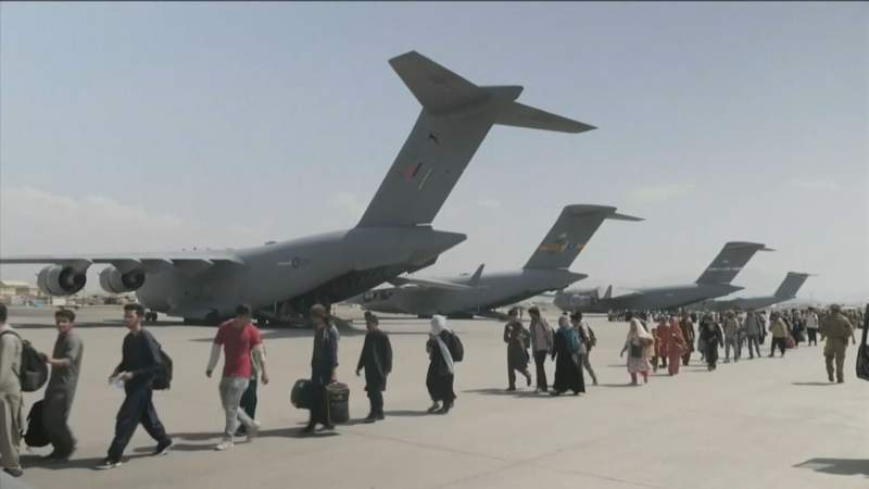 People fleeing Afghanistan following Taliban takeover of country's government.