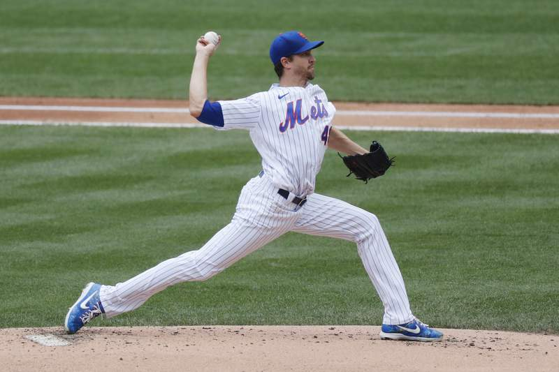 New York Mets starting pitcher Jacob deGrom winds up during the first inning of a baseball game against the Miami Marlins at Citi Field, Sunday, Aug. 9, 2020, in New York. (AP Photo/Kathy Willens)