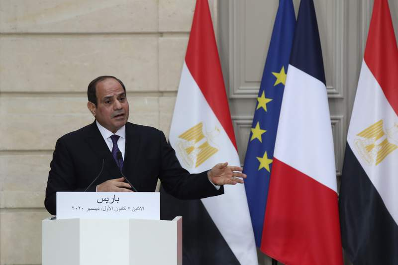Egyptian President Abdel-Fattah el-Sissi speaks during a joint press conference with French President Emmanuel Macron at the Elysee palace, Monday, Dec. 7, 2020 in Paris. Egyptian President Abdel-Fattah el-Sissi was meeting Monday with French President Emmanuel Macron for talks on fighting terrorism, the conflict in Libya and other regional issues as part of a state visit to France, amid criticism from human rights groups over the Egyptian leader's crackdown on dissent. (AP Photo/Michel Euler, Pool)