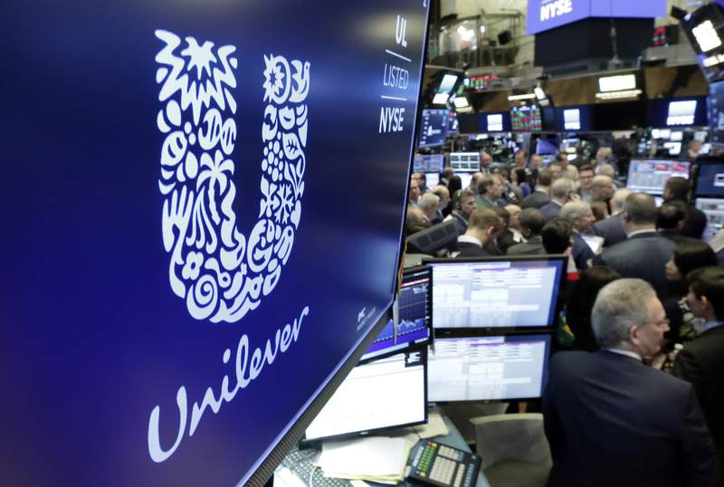 FILE - In this Thursday, March 15, 2018 file photo, the logo for Unilever appears above a trading post on the floor of the New York Stock Exchange.  Consumer products giant Unilever, said Thursday July 23, 2020, that second-quarter sales were only slightly lower than the same period a year ago despite the lockdown measures triggered by the global fight against the coronavirus.(AP Photo/Richard Drew, File)