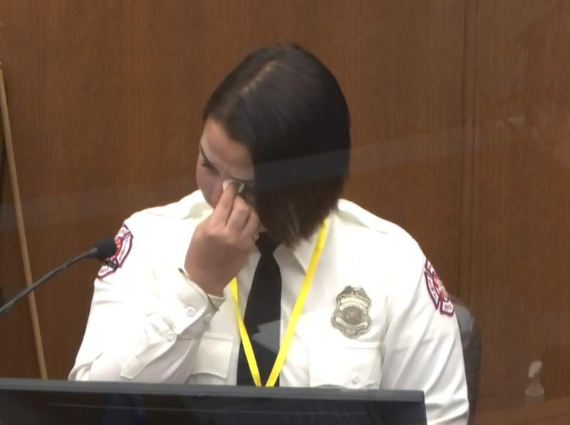 In this image from video, Minneapolis Firrefighter Genevieve Hansen, wipes her eyes as she testifies as Hennepin County Judge PeterCahill presides Tuesday, March 30, 2021, in the trial of former Minneapolis police Officer Derek Chauvin, in the May 25, 2020, death of George Floyd at the Hennepin County Courthouse in Minneapolis, Minn. (Court TV via AP, Pool)