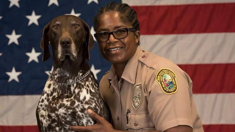 Officer Regina Dean, right, worked with Ares, a Miami-Dade police dog, until his death on Wednesday.