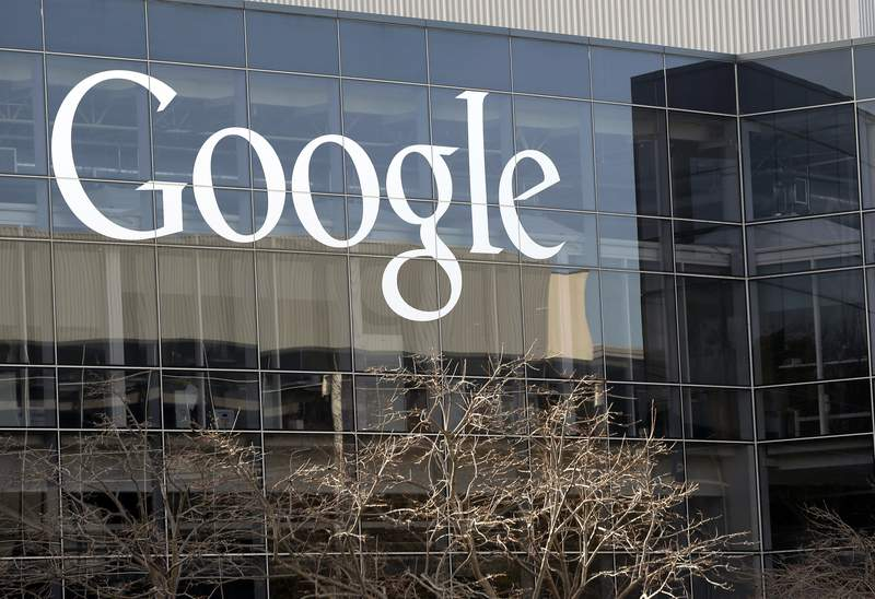 FILE - This Thursday, Jan. 3, 2013, file photo shows Google's headquarters in Mountain View, Calif.  Google said Thursday, Oct. 1, 2020,  it will pay publishers $1 billion over the next three years for their news content. The internet search giant said it has signed agreements for its news partnership program with nearly 200 publications in Germany, Brazil, Argentina, Canada, the U.K. and Australia.  (AP Photo/Marcio Jose Sanchez, File)
