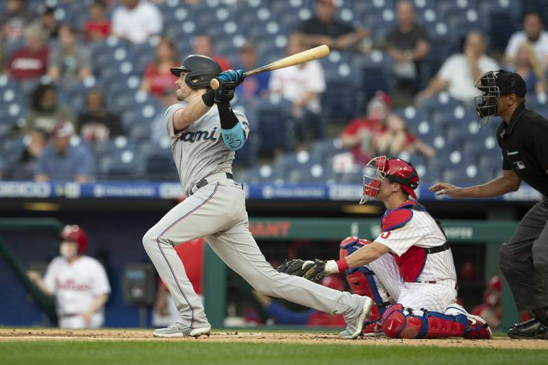 Brian Anderson of the Miami Marlins hits a solo home run in the top of the second inning against the Philadelphia Phillies at Citizens Bank Park on May 19, 2021 in Philadelphia, Pennsylvania.