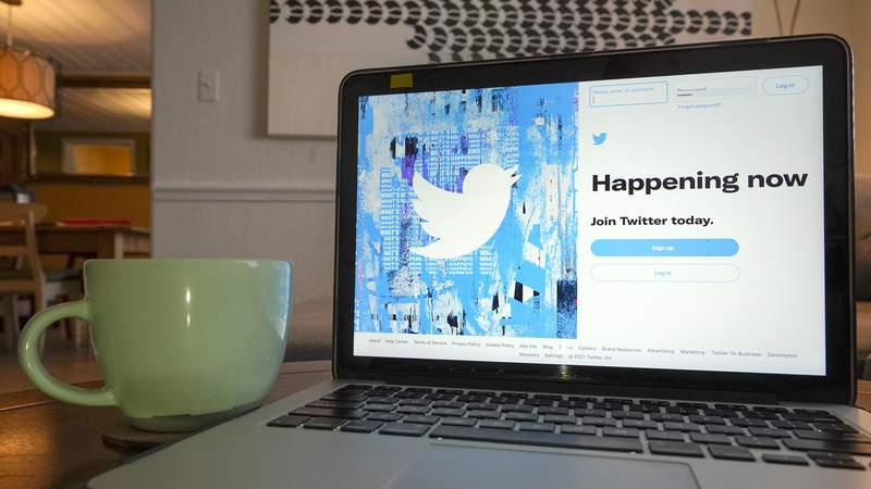 The login/sign up screen for a Twitter account is seen on a laptop computer Tuesday, April 27, 2021, in Orlando, Fla.  Twitter is rolling out a subscription service, starting in Canada and Australia, that offers perks like an undo button for subscribers. (AP Photo/John Raoux)
