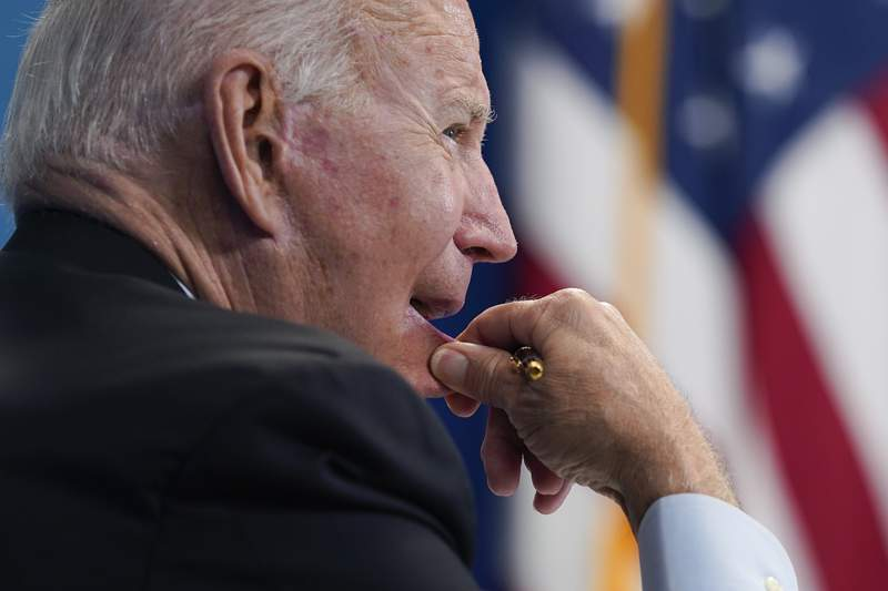 President Joe Biden listens during a virtual meeting with FEMA Administrator Deanne Criswell and governors and mayors of areas impacted by Hurricane Ida, in the South Court Auditorium on the White House campus, Monday, Aug. 30, 2021, in Washington. (AP Photo/Evan Vucci)