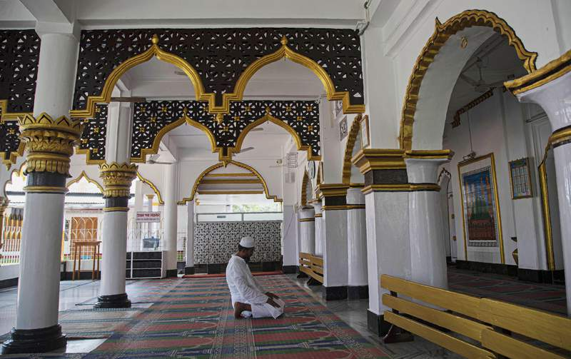An Indian Muslim man prays in a Mosque during the nationwide lockdown to prevent the spread of new coronavirus in Gauhati, India, Monday, April 27, 2020. The U.S. Commission on International Religious Freedom is urging that the State Department add India to its list of nations with uniquely poor records on protecting freedom to worship, while proposing to remove Sudan and Uzbekistan from that list. (AP Photo/Anupam Nath)