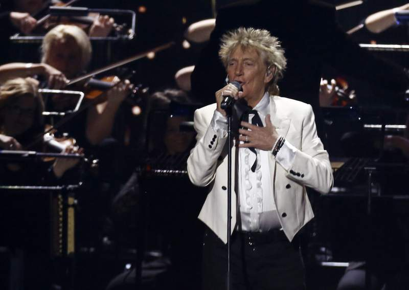 FILE - In this Feb. 18, 2020 file photo, Rod Stewart performs on stage at the Brit Awards 2020 in London. A Florida judge on Thursday, Sept. 9, 2021, has canceled the trial for Stewart and his adult son and scheduled a hearing next month to discuss a plea deal to resolve misdemeanor charges. The singer of 70s hits such as Da Ya Think Im Sexy? and Maggie May and his son are accused of pushing and shoving a security guard at an upscale hotel because he wouldnt let them into a New Years Eve party nearly two years ago.  (Photo by Joel C Ryan/Invision/AP, File)