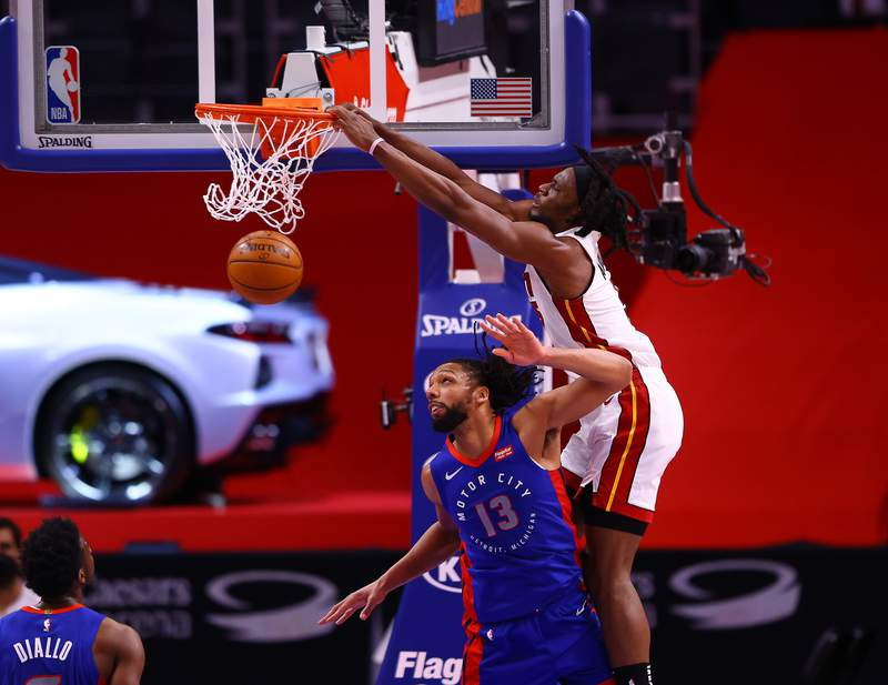 Precious Achiuwa of the Miami Heat dunks the ball over Jahlil Okafor of the Detroit Pistons in the second half at Little Caesars Arena on May 16, 2021 in Detroit, Michigan.