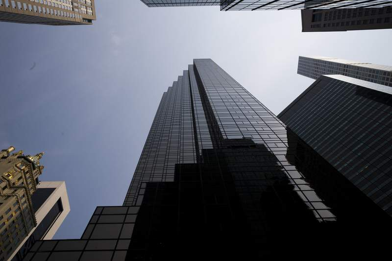 FILE - In this Aug. 27, 2018, photo, Trump Tower, center, stands on New York's Fifth Avenue. An obscure function of Congress may have once put President Donald Trump's tax information in the hands of congressional staff. But even if it did, that doesn't mean staffers can give access to Trump's tax returns to lawmakers, at least not legally. (AP Photo/Mark Lennihan, File)