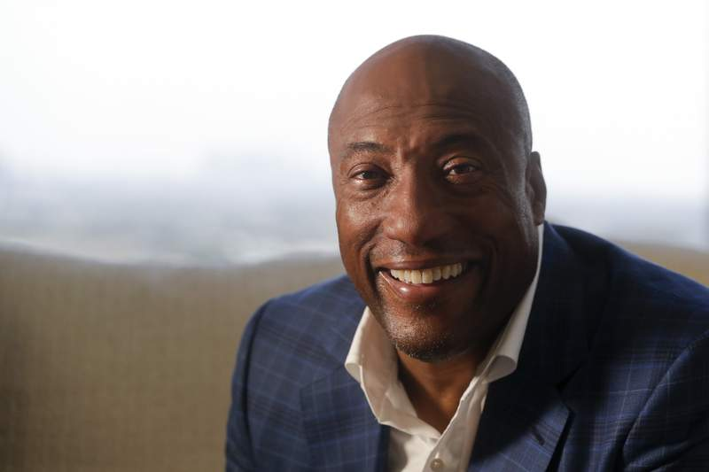 FILE - In this Sept. 5, 2019 file photo, comedian and media mogul Byron Allen poses for a picture in Los Angeles. Allen and Comcast have settled a long-running a long-running racial discrimination dispute, and the cable giant will add three of the black media moguls channels to its cable packages.  (AP Photo/Chris Carlson, File)