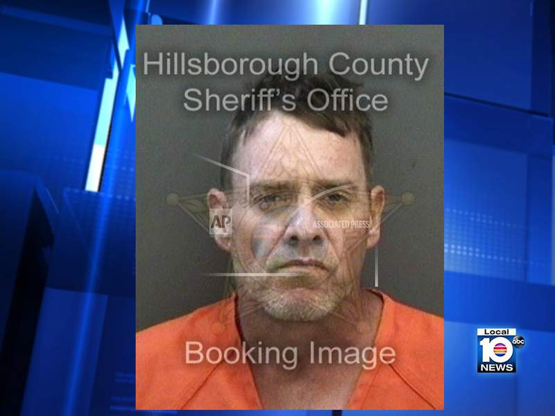 In this undated booking photo from Hillsborough County Sheriff Office shows Jonathan Day in Tampa, Fla. Day, 41, is facing charges of battery on an officer, resisting an officer with violence and depriving an officer of means of protection or communication after allegedly tossing golf clubs on Interstate 75 near Tampa. (Hillsborough County Sheriff via AP)