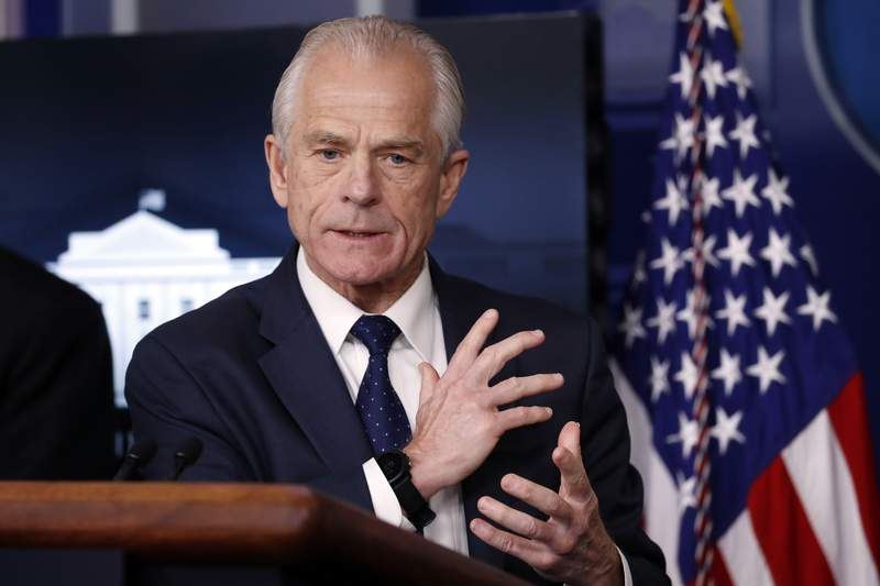 FILE - White House trade adviser Peter Navarro, who is now serving as national defense production act policy coordinator, speaks in the James Brady Press Briefing Room of the White House in Washington on April 2, 2020.  USA Today says that Navarro's column about Dr. Anthony Fauci that it solicited and published did not meet its fact-checking standards. Navarro's column, saying that the nation's top infectious disease expert had been wrong about everything he had interacted with him on, ran in Wednesday's newspaper and online a night earlier. USA Today also ran a fact-checking column debunking some of Navarro's claims. (AP Photo/Alex Brandon, File)