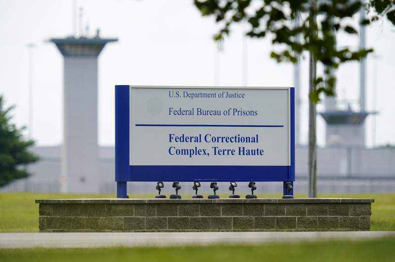 FILE - This Aug. 28, 2020, file photo shows the federal prison complex in Terre Haute, Ind. The Justice Department is quietly amending its execution protocols, no longer requiring federal death sentences to be carried out by lethal injection and clearing the way for other methods like firing squads and poison gas. The amended rule, published Friday, Nov. 27, in the Federal Register, allows the U.S. government to conduct executions by lethal injection or use any other manner prescribed by the law of the state in which the sentence was imposed. (AP Photo/Michael Conroy, File)