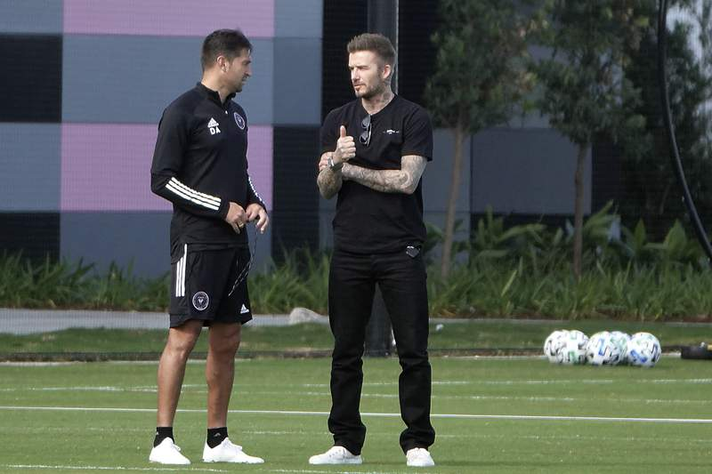 InterMiami co-owner David Beckham, right, talks with coach Diego Alonso during an MLS training session, Thursday, March 12, 2020, in Fort Lauderdale.