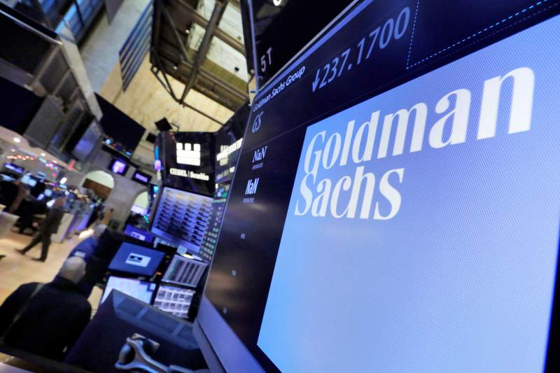 FILE - In this Dec. 13, 2016, file photo, the logo for Goldman Sachs appears above a trading post on the floor of the New York Stock Exchange. Goldman Sachs had the second-best quarterly profit in the firm's history in the quarter ended in June 2021, helped by a strong performance in its investment banking division that more than made up for a decline in trading revenues.  (AP Photo/Richard Drew, File)