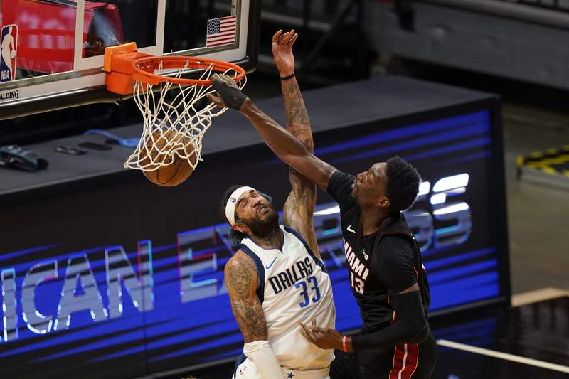 Miami Heat center Bam Adebayo dunks the ball against Dallas Mavericks center Willie Cauley-Stein during the first half of an NBA basketball game, Tuesday, May 4, 2021, in Miami.