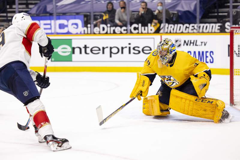Juuse Saros of the Nashville Predators defends the net against a shot by Sam Bennett of the Florida Panthers during the second period at Bridgestone Arena on April 26, 2021 in Nashville, Tennessee.