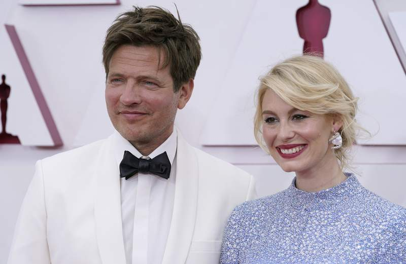 Thomas Vinterberg, left, and Helene Reingaard Neumann arrive at the Oscars on Sunday, April 25, 2021, at Union Station in Los Angeles. (AP Photo/Chris Pizzello, Pool)