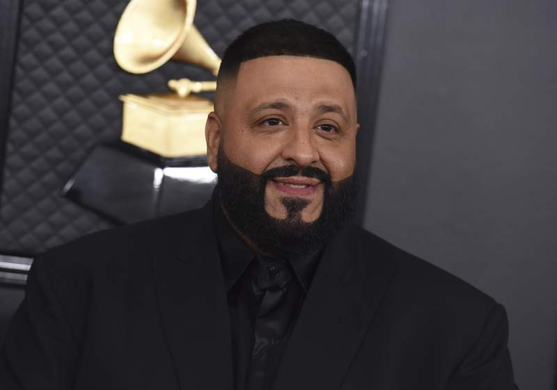 """FILE - DJ Khaled arrives at the 62nd annual Grammy Awards on Jan. 26, 2020, in Los Angeles. DJ Khaled latest maximalist album, """"Khaled Khaled,"""" features a total of 29 rappers and singers across 13 tracks. (Photo by Jordan Strauss/Invision/AP, File)"""