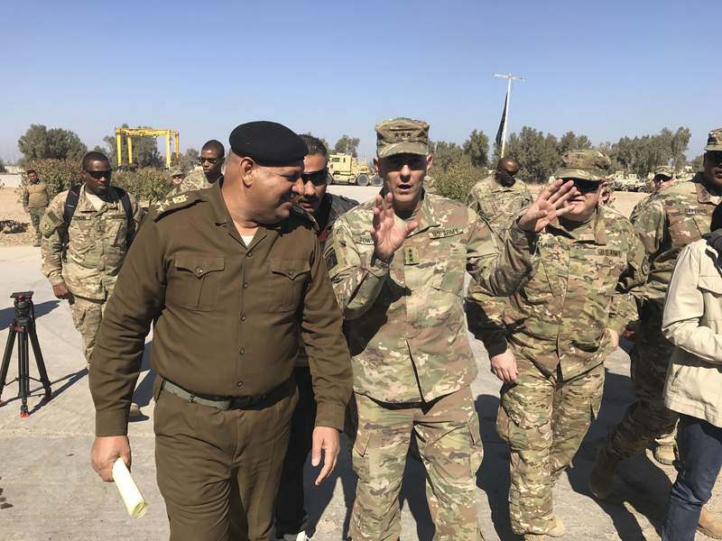 FILE - In this Feb. 8, 2017, file photo, then-Army Lt. Gen. Stephen Townsend talks with an Iraqi officer during a tour north of Baghdad, Iraq. Townsen, now a general, says a growing military threat from China may well come from Americas east, as Beijing looks to establish a large navy port capable of hosting submarines or aircraft carriers on the Atlantic coast of Africa.(AP Photo/ Ali Abdul Hassan, File)
