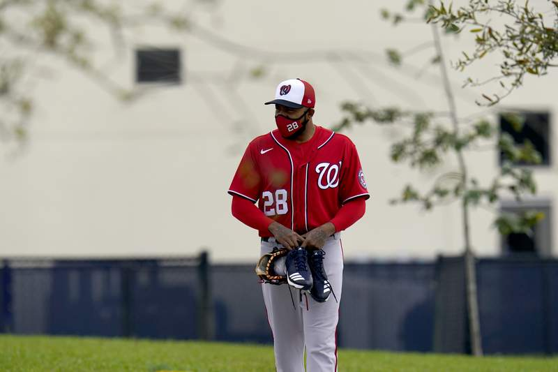 Washington Nationals pitcher Jeremy Jeffress walks out for spring training baseball practice Thursday, Feb. 25, 2021, in West Palm Beach, Fla. (AP Photo/Jeff Roberson)