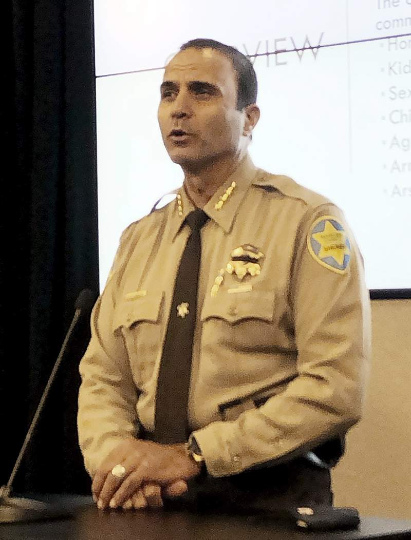 Maricopa County Sheriff Paul Penzone is shown at an Aug. 12, 2020, news conference at his office in Phoenix. A court-appointed official has criticized Penzone's efforts to reduce a backlog of 1,800 internal affairs case against his officers and complained the sheriff hasn't heeded his team's suggestions for chipping away at the backlog.  (AP Photo/Jacques Billeaud)