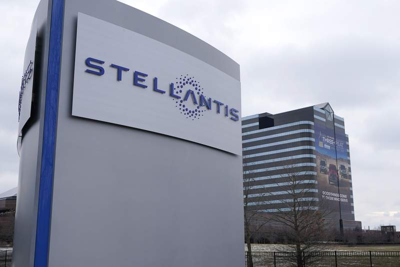 FILE - This Jan. 19, 2021 file photo shows the Stellantis sign outside the Chrysler Technology Center in Auburn Hills, Mich.   Automaker Stellantis says, Tuesday, Aug. 3,  it achieved faster-than-expected progress on synergies and record margins in its first six months as a combined company, despite suffering 700,000 units in lower production due to interruptions in the semiconductor supply chain.  (AP Photo/Carlos Osorio)