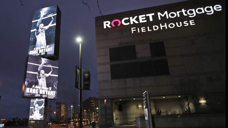 FILE - In this Jan. 28, 2020, file photo, images of Kobe Bryant are displayed as fans enter Rocket Mortgage Fieldhouse for an NBA basketball game between the Cleveland Cavaliers and the New Orleans Pelicans in Cleveland. The Rock & Roll Hall of Fame announced Tuesday, March 2, 2021, that the 2021 induction ceremony will take place at Rocket Mortgage FieldHouse in Cleveland on October 30. (AP Photo/Tony Dejak, File)