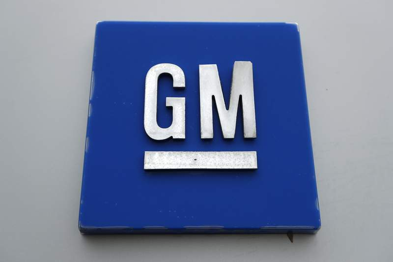 FILE - This Jan. 27, 2020, file photo shows a General Motors logo at the General Motors Detroit-Hamtramck Assembly plant in Hamtramck, Mich. General Motors is taking a $2 billion equity stake in Nikola that will see it engineer and make the company's Badger, a fully-electric and hydrogen fuel cell electric pickup truck.  (AP Photo/Paul Sancya, File)