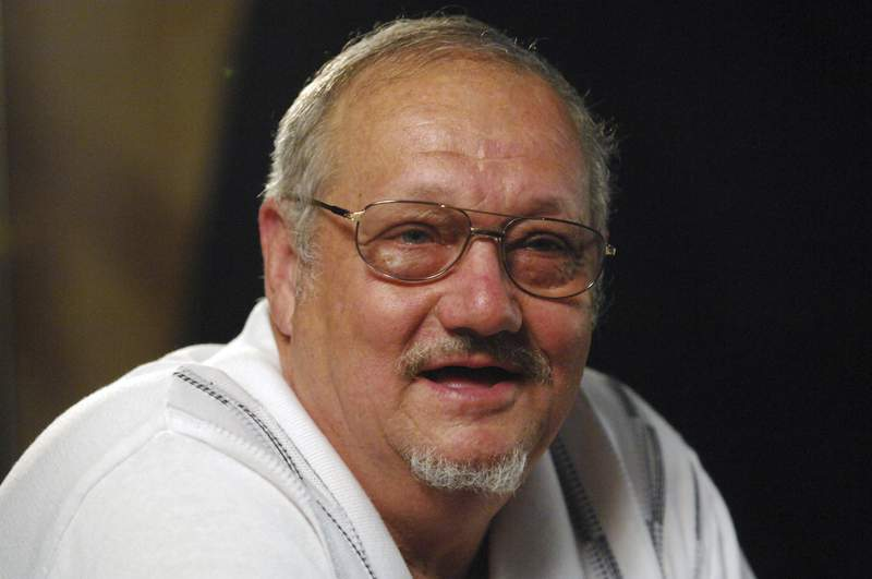 In this Aug. 30, 2007 photo Jack Whittaker speaks during an interview in Mount Hope, W.Va. Whittaker Jr., whose life became rife with setbacks and tragedy after winning a record $315 Powerball jackpot on Christmas night in 2002, has died. He was 72. On Tuesday, June 30, 2020, Ronald Meadows Funeral Parlor in Hinton, West Virginia confirmed Whittakers death. (AP Photo/Jeff Gentner)
