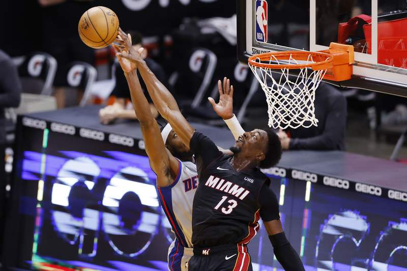 Bam Adebayo of the Miami Heat blocks a shot by Jerami Grant of the Detroit Pistons during the fourth quarter at American Airlines Arena on January 18, 2021 in Miami, Florida.