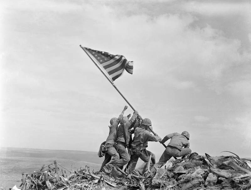 FILE - In this Feb 23, 1945 file photo, U.S. Marines of the 28th Regiment, 5th Division, raise a U.S. flag atop Mt. Suribachi, Iwo Jima, Japan. Dave Severance, the Marine company commander whose troops planted the flag during World War II, a moment captured in one of the most iconic war photographs in history, has died. He was 102. Severance died Monday, Aug. 2, 2021, at his home in the San Diego suburb of La Jolla, according to the San Diego Union-Tribune. (AP Photo/Joe Rosenthal, File)