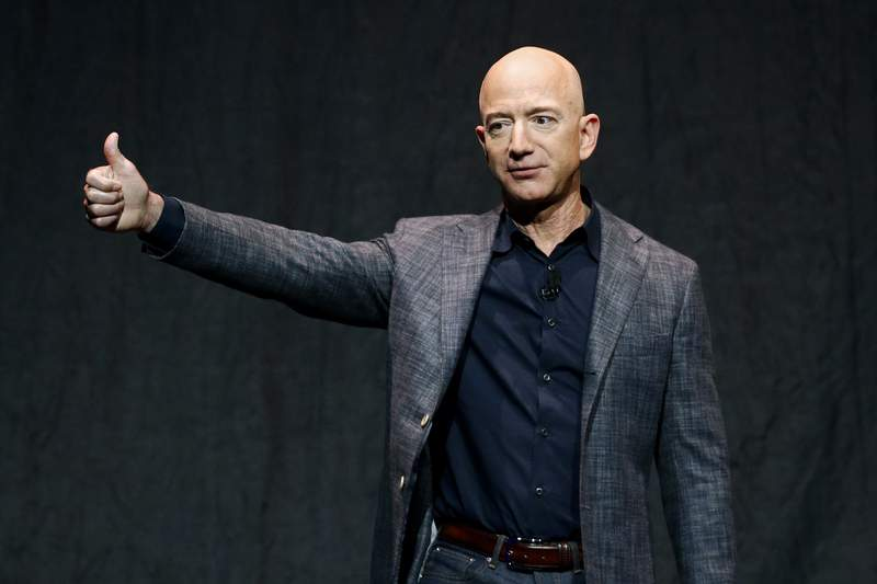 FILE - In this Thursday, May 9, 2019, file photo, Jeff Bezos speaks at an event before unveiling Blue Origin's Blue Moon lunar lander, in Washington. On Monday, July 12, 2021, the Federal Aviation Administration approved Blue Origin's attempt to launch people into space. (AP Photo/Patrick Semansky, File)