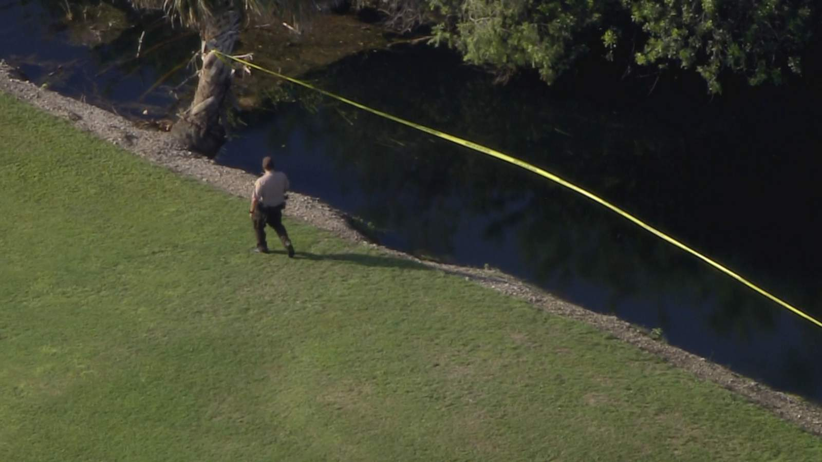 Sky 10 over a canal where a body was pulled from Friday morning.