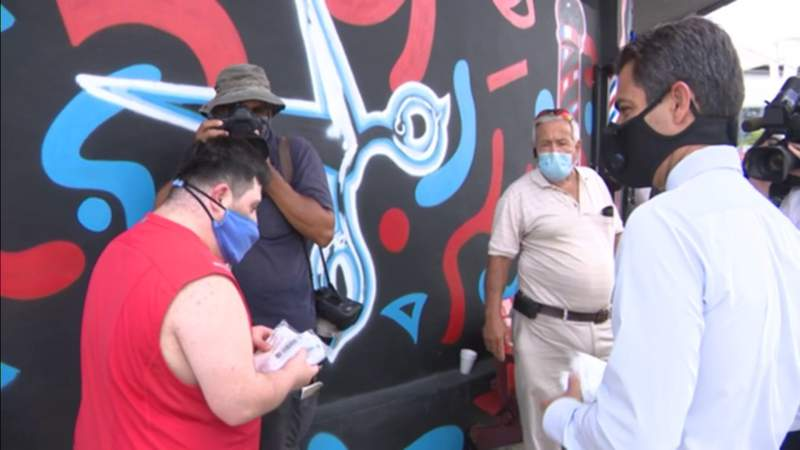 Miami officials pass out free masks to residents in coronavirus hot spots