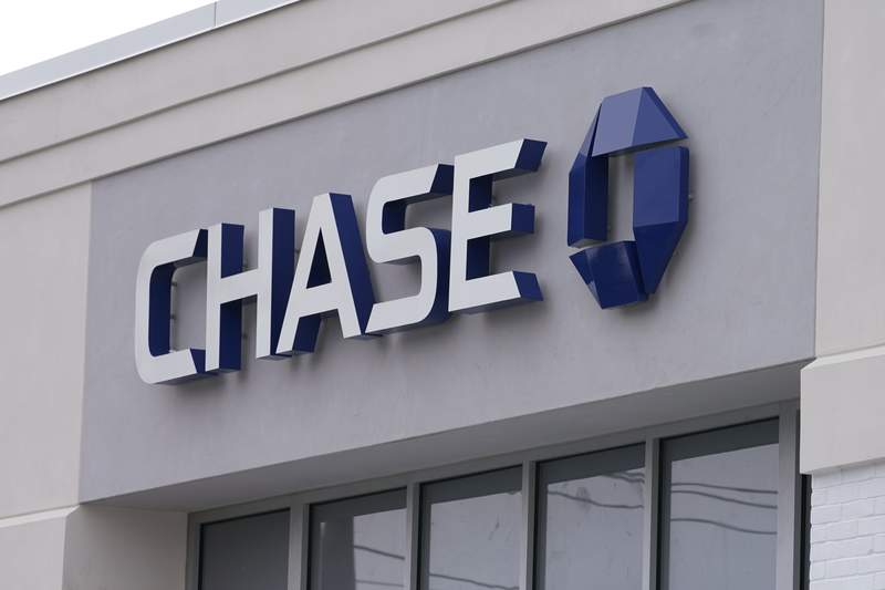 A Chase Bank is seen, Wednesday, Feb. 3, 2021, in Woburn, Mass.  The nations largest banks are expected to report big profits for the first quarter, Tuesday, April 13,  amid renewed confidence that pandemic-battered consumers and businesses can repay their debts and start borrowing again. (AP Photo/Elise Amendola)