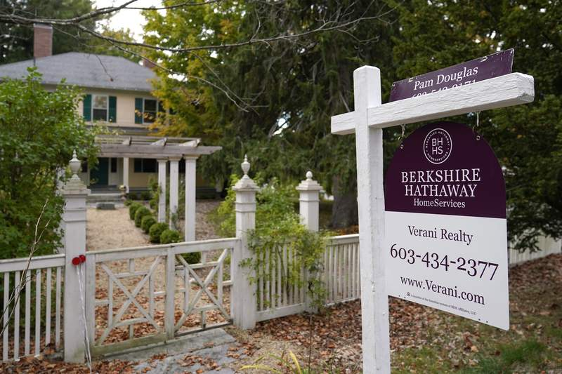 FILE - In this Sept. 29, 2020 file photo, a for sale sign stands outside a residential home in East Derry, N.H. U.S. long-term mortgage rates ticked up this week but remain at historic lows as the coronavirus pandemic continues to batter the economy even as more Americans get vaccinated. Mortgage buyer Freddie Mac reported Thursday, Feb. 18, 2021 that the average rate on the benchmark 30-year fixed-rate home loan rose to 2.81% from last weeks 2.73%.   (AP Photo/Charles Krupa)