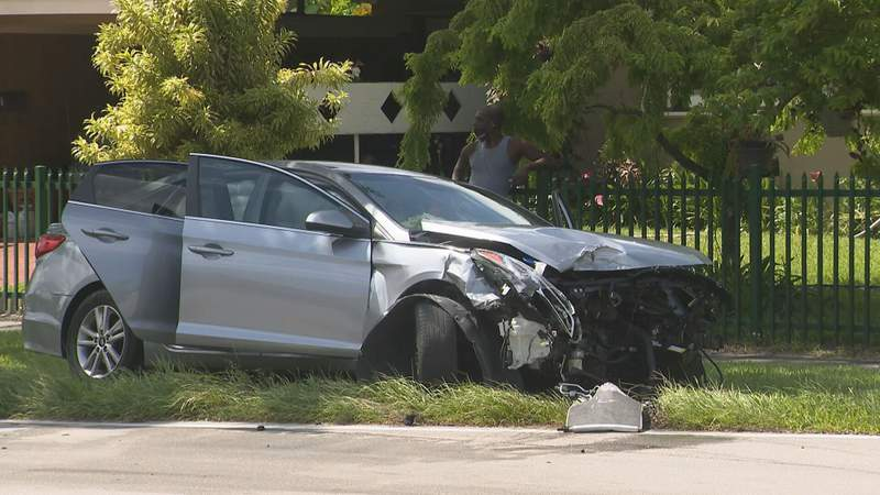 A vehicle crashed in Miami Gardens after the driver said they were fleeing from a shooting between two other cars.