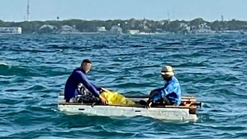 Two Cubans in a 10-foot styrofoam hull rustic vessel are intercepted near Key West, Aug. 3, 2021.
