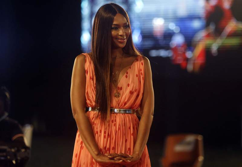 FILE - In this Sunday, Dec. 13, 2020 file photo, British model Naomi Campbell attends ARISE Fashion Week event in Lagos, Nigeria. Naomi Campbell says she has become mother to a baby girl. The 50-year-old supermodel announced the news Tuesday, May 18, 2021 on Instagram, posting a picture of her hand holding a babys feet.  (AP Photo/Sunday Alamba, file)