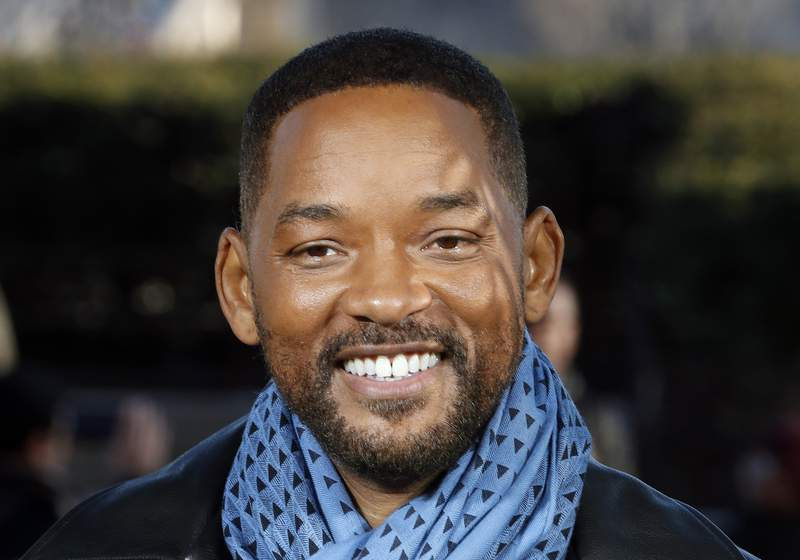 """FILE - In this Monday, Jan. 6, 2020, file photo, U.S actor Will Smith poses for photographers during the photo call of """"Bad Boys for Life,"""" in Paris.  Smith is ready to open up about his life story. Penguin Press announced Sunday, June 20, 2021, that Smith will release his memoir called Will on Nov. 9. The actor-rapper shared a photo of the books cover art to more than 54 million followers on Instagram. Smith said he is finally ready to release his memoir after working on his book for the past two years. (AP Photo/Thibault Camus, File)"""