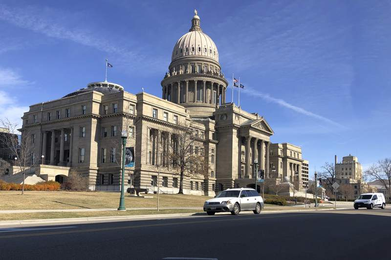 FILE- In this March 4, 2020, file photo, is the Idaho Statehouse in Boise, Idaho.  The Idaho Legislature has voted to shut down for several weeks due to an outbreak of COVID-19. Lawmakers in the House and Senate made the unprecedented move on Friday, March 19, 2021,  with significant unfinished business, including setting budgets and pushing through a huge income tax cut.   (AP Photo/Keith Ridler, File)