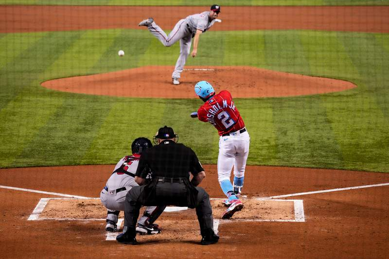 Jazz Chisholm Jr. of the Miami Marlins hits a triple in the first inning against the Washington Nationals at loanDepot park on June 27, 2021 in Miami, Florida.