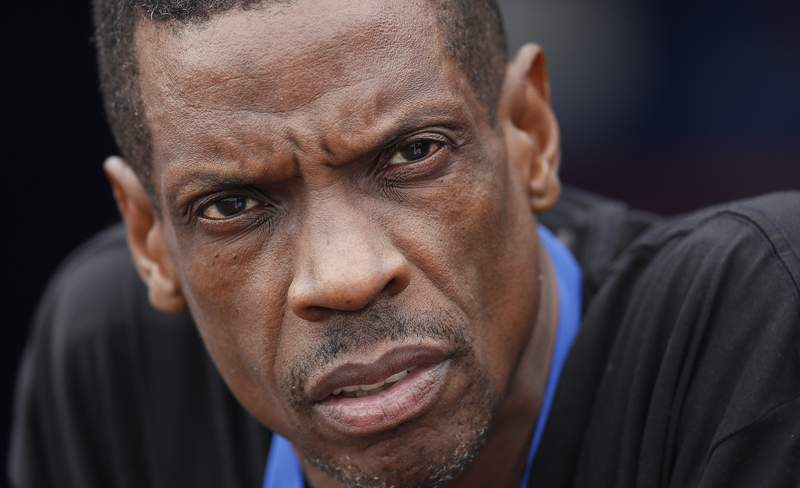 """FILE - In this Monday, March 13, 2017 file photo, Former New York Mets pitcher Dwight """"Doc"""" Gooden watches batting practice before inning of a spring training baseball game between the Mets and the Miami Marlins in Port St. Lucie, Fla. Gooden has been sentenced to a year of probation in connection with a drug arrest in New Jersey in 2019. Gooden appeared before a judge in a virtual proceeding on Thursday, Nov. 12, 2020. He had pleaded guilty in August 2019 to one count of cocaine possession stemming from a traffic stop in Holmdel, about 20 miles (30 kilometers) from New York, in June 2019.    (AP Photo/John Bazemore, File)"""