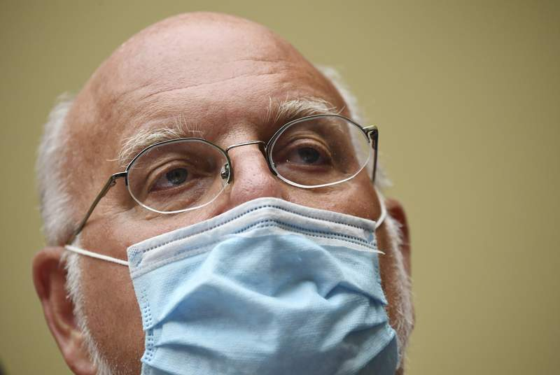 Dr. Robert Redfield, director of the Centers for Disease Control and Prevention (CDC), testifies during a House Subcommittee hearing on the Coronavirus crisis, Friday, July 31, 2020 on Capitol Hill in Washington.  (Kevin Dietsch/Pool via AP)