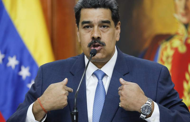 Venezuelan President Nicolas Maduro gives a press conference at Miraflores presidential palace in Caracas, Venezuela, Friday, Feb. 14, 2020. Maduro said Friday that authorities havent detained opposition leader Juan Guaido because the courts havent ordered it, but he warned: It will come. (AP Photo/Ariana Cubillos)