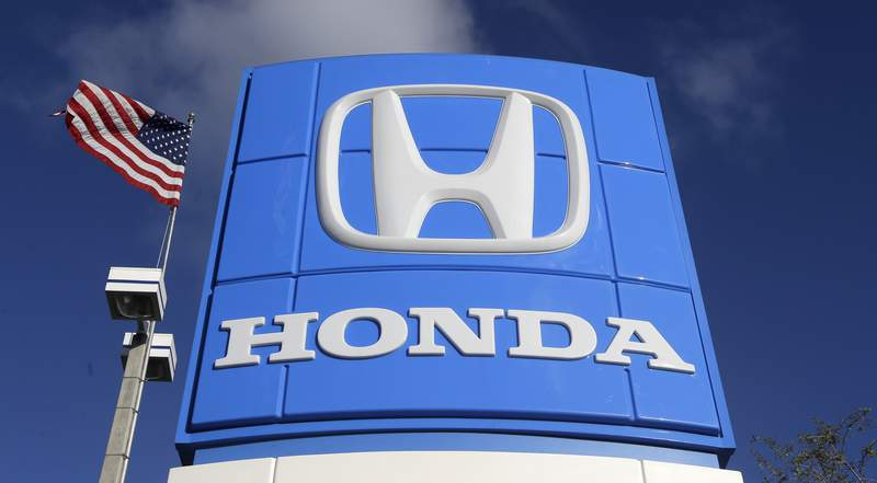 FILE - This Tuesday, Jan. 13, 2015, file photo shows a sign at a Honda dealership in Miami Lakes, Fla. Japanese automaker Honda said Friday, April 23, 2021 that it plans to phase out all of its gasoline-powered vehicles in North America by 2040, making it the latest major automaker with a goal of becoming carbon neutral. The announcement came as leaders of the major global economies met for President Joe Biden's climate summit.  (AP Photo/Alan Diaz, File)